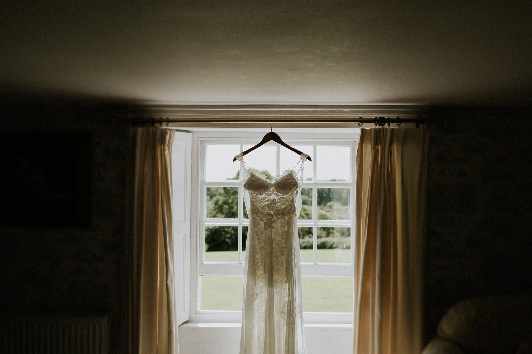 brides dress hanging in the window