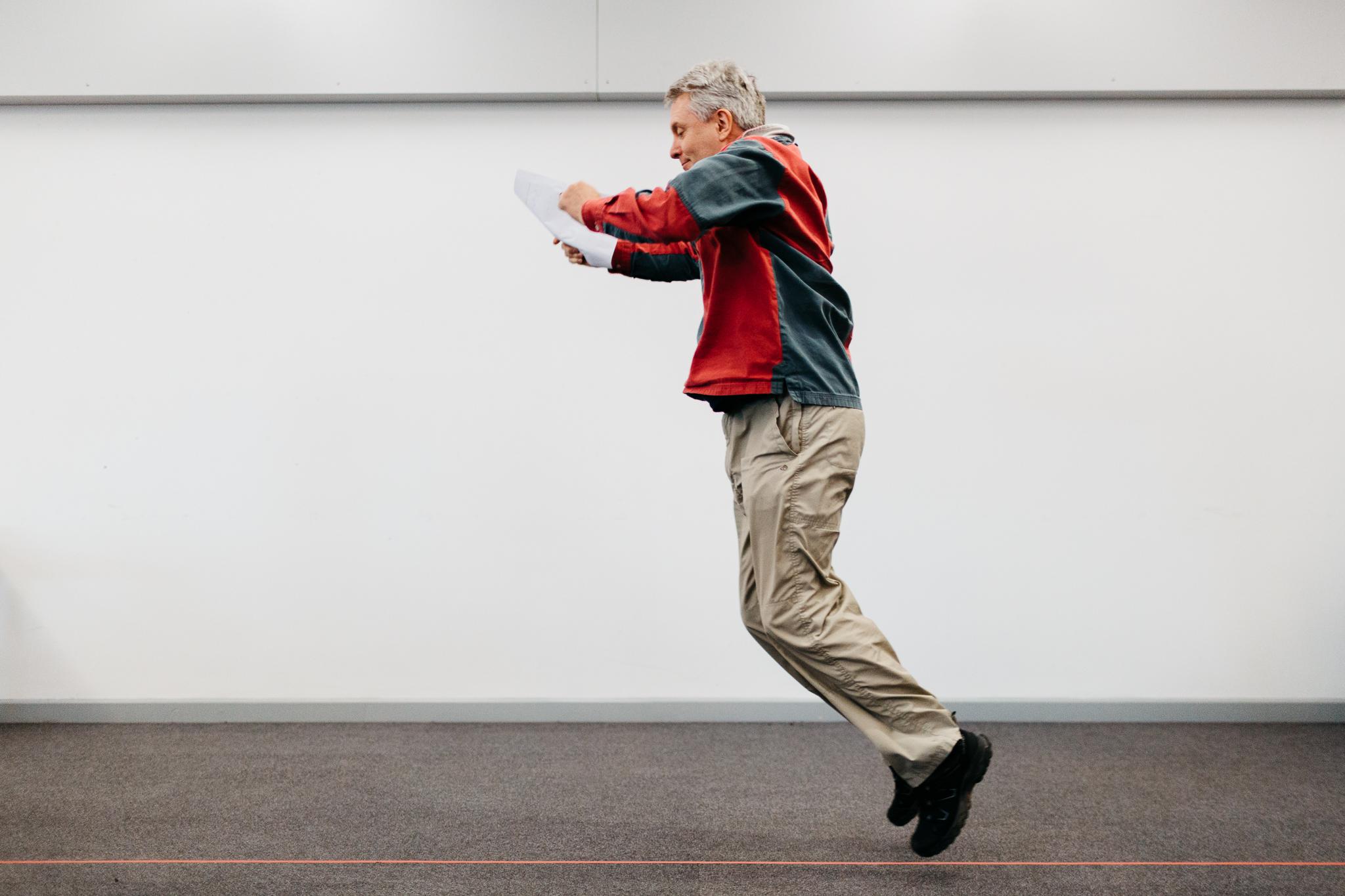 man jumping through air during a workshop at a festival