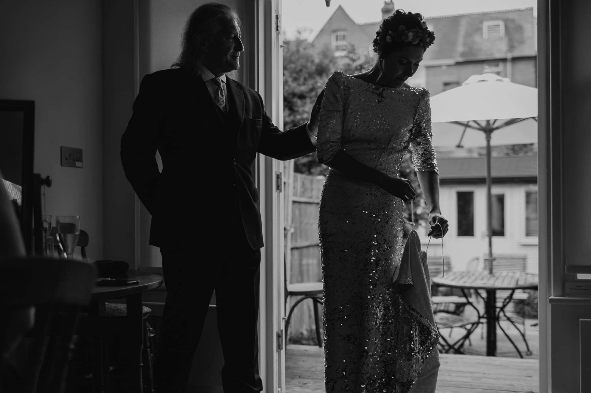 bride with father of the bride in front room