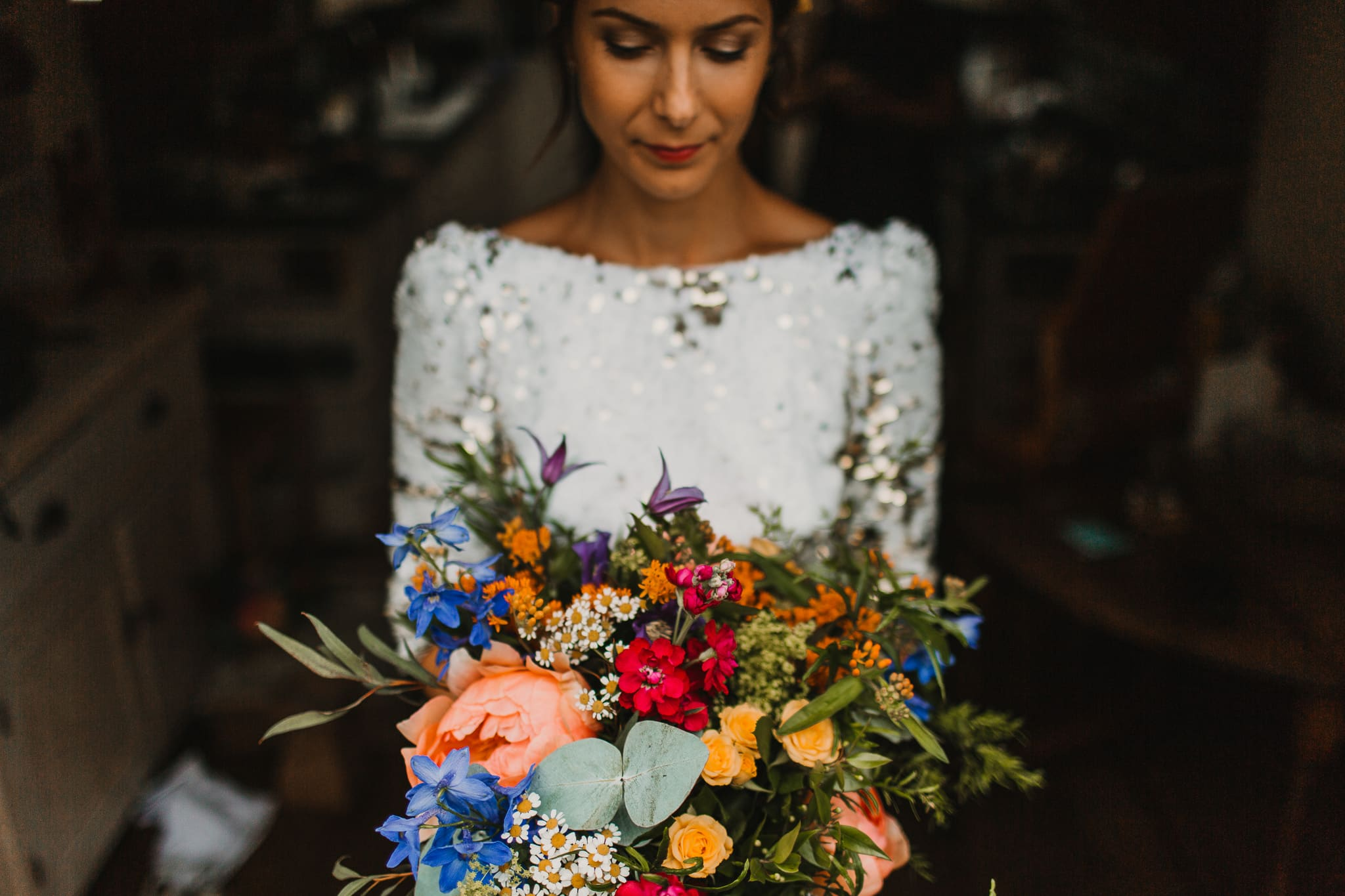 bride with flowers in window light