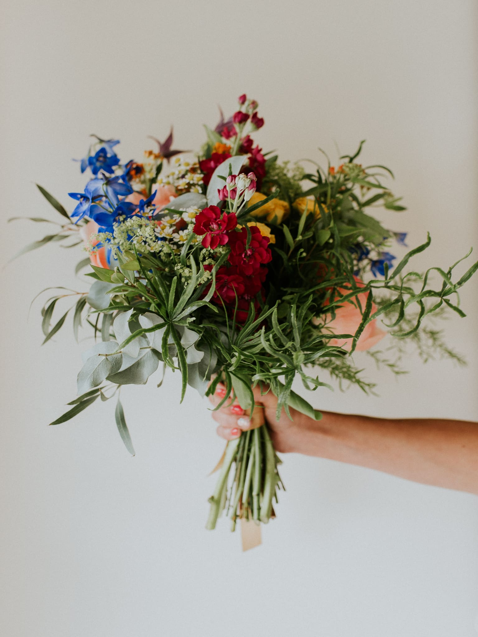 bridal flowers infront of a white wall
