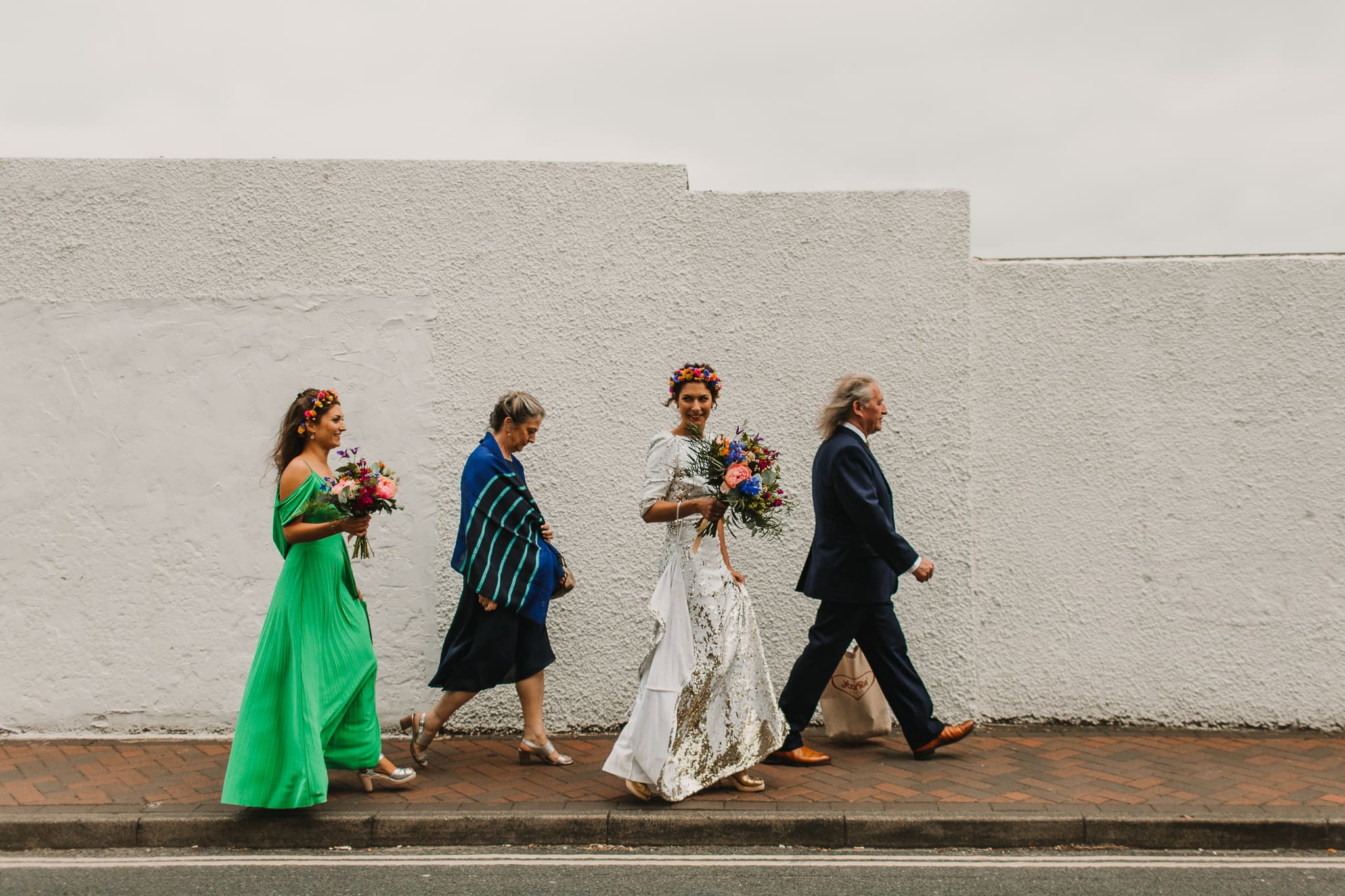 bride with family walking through street