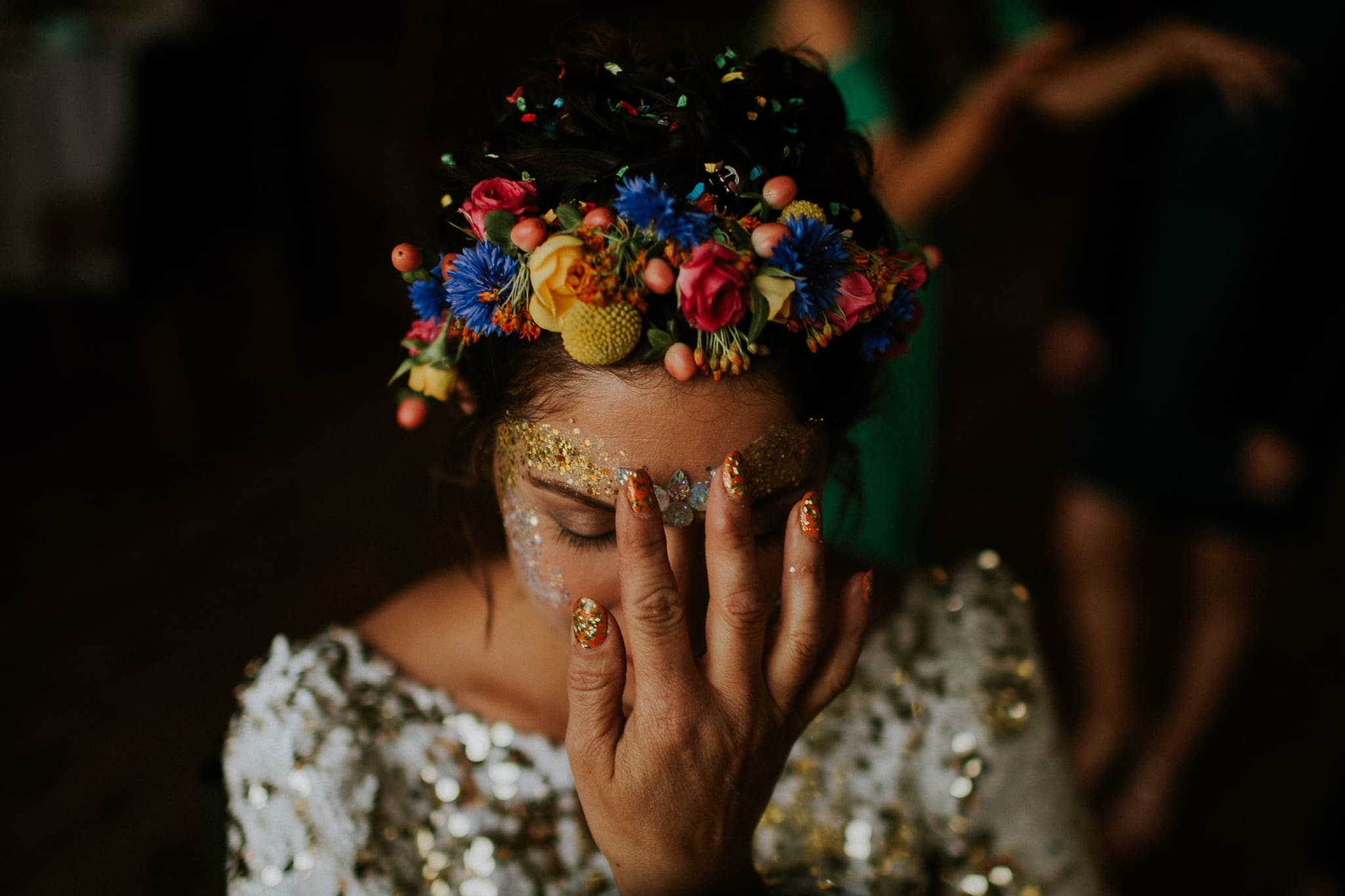 bride having glitter applied to face