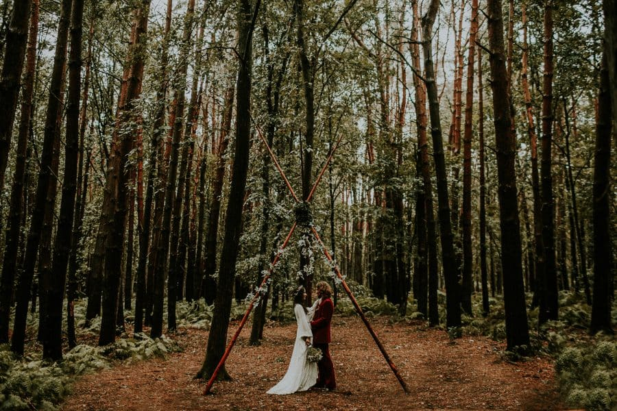 bride and groom in a wood