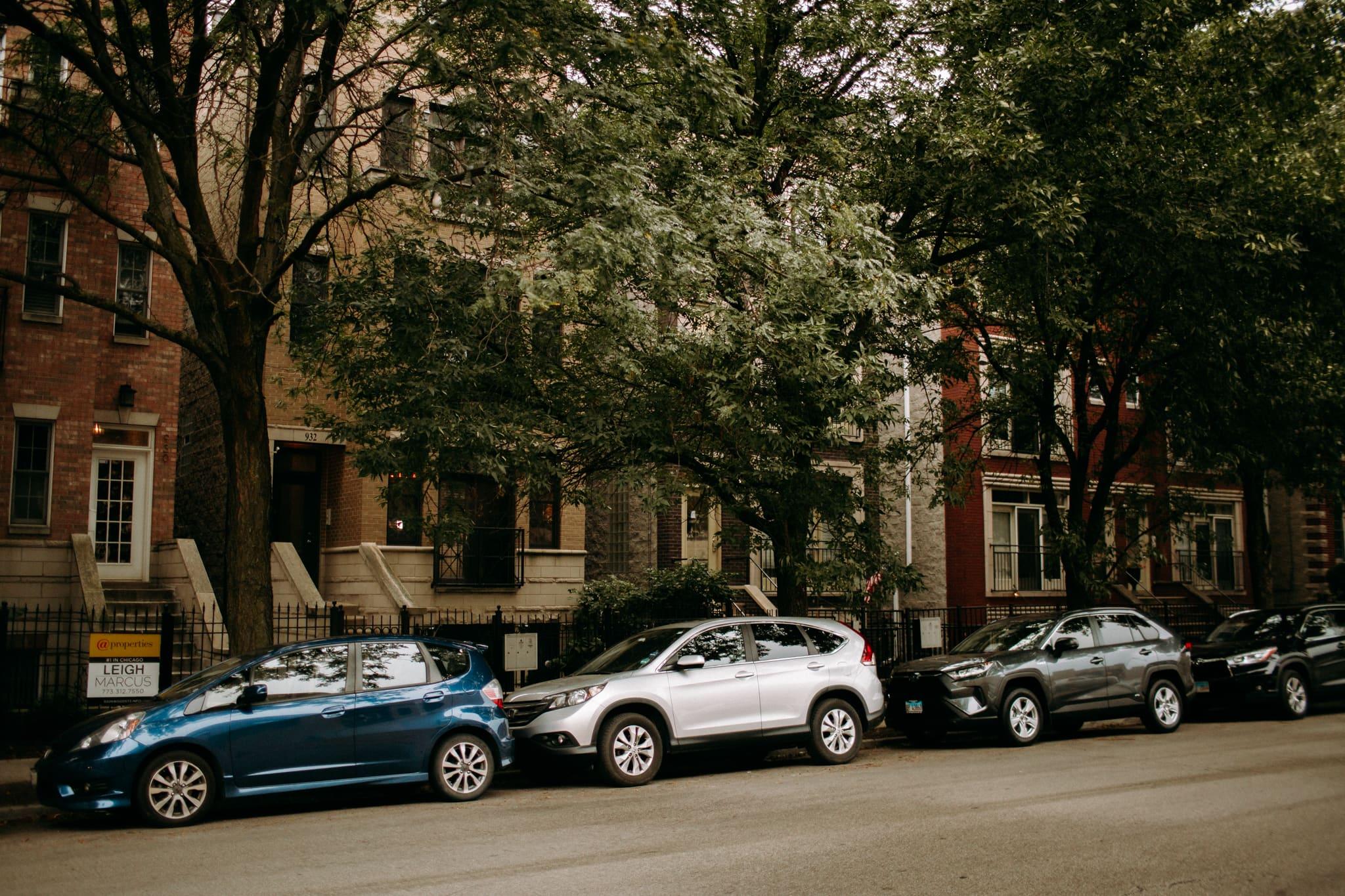 cars on a chicago street in a neighbourhood