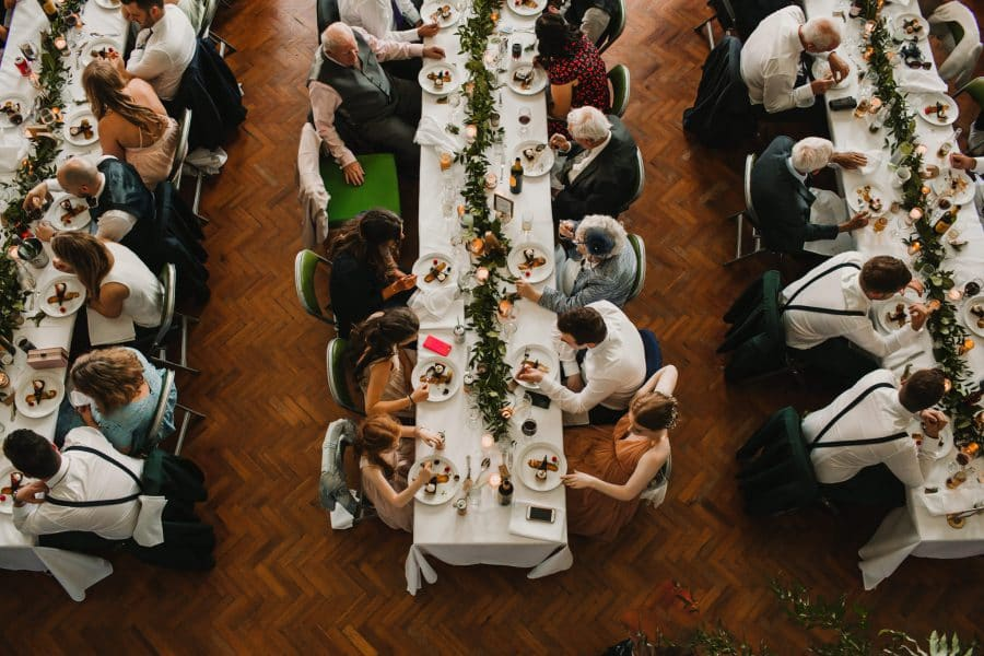 wedding guest eating food at large wedding tables